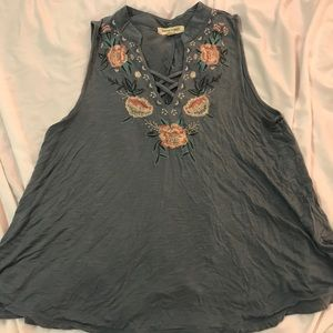 Embroidered flowy tank.